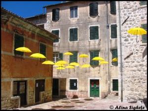 3 yellow umbrellas